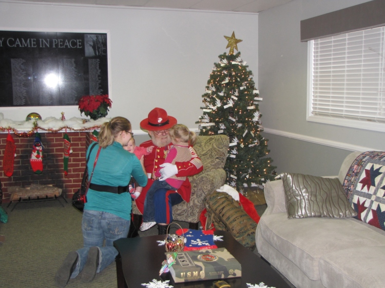 Children of Marines and sailors at Camp Lejeune and MCAS New River receive gifts from Gunny Claus. USO photo.