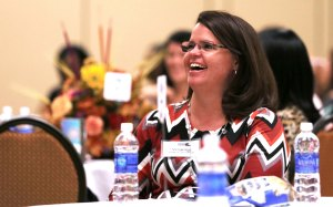 Virginia Peacock laughs during a presentation at the USO Caregivers Conference in Fayetteville, North Carolina, last month. USO photo by Eric Brandner