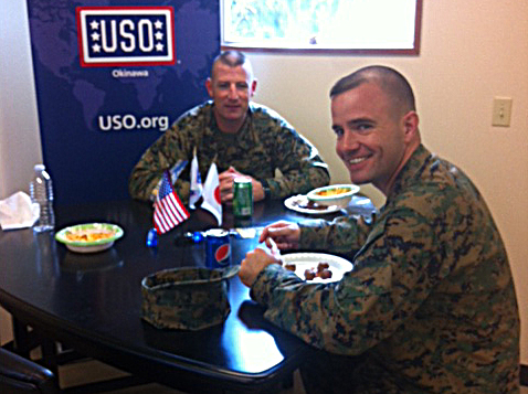 Marines enjoy a Christmas meal at the Camp Courtney  USO in Okinawa, Japan. USO photo