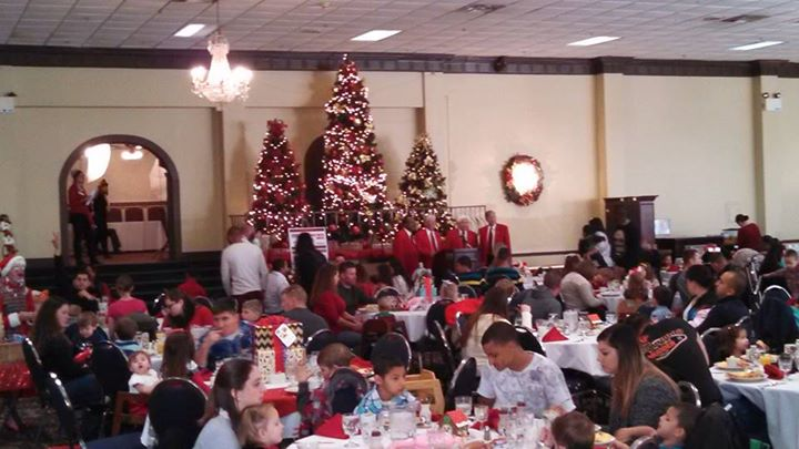 The room was full of military families celebrating the holidays with the USO.