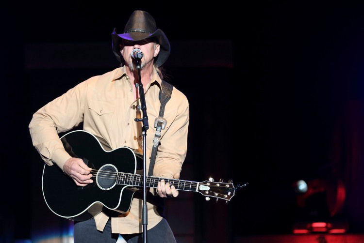 Trace Adkins performs for thousands of troops and their families at a concert at Fort Hood, Texas, on November 1. USO photo by Fred Greaves