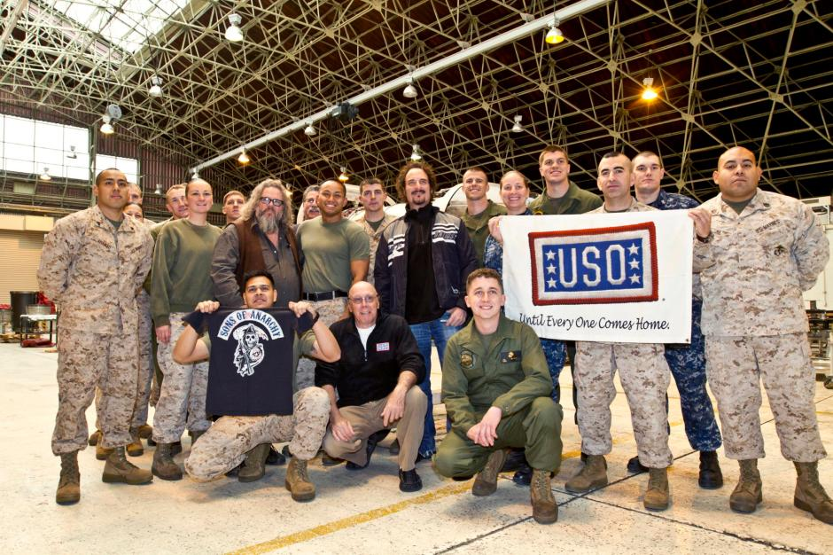 """""""Sons of Anarchy"""" stars Dayton Callie (front row center), Mark Boone Junior (second row l-r) and Kim Coates pose for a group photo with Marines in Japan, March 14, 2013. USO Photo by Michael Clifton"""