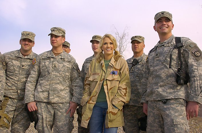 Country music singer Carrie Underwood greets service members during a USO stop at Camp Anaconda on December 16, 2006. USO photo by Mike Theiler