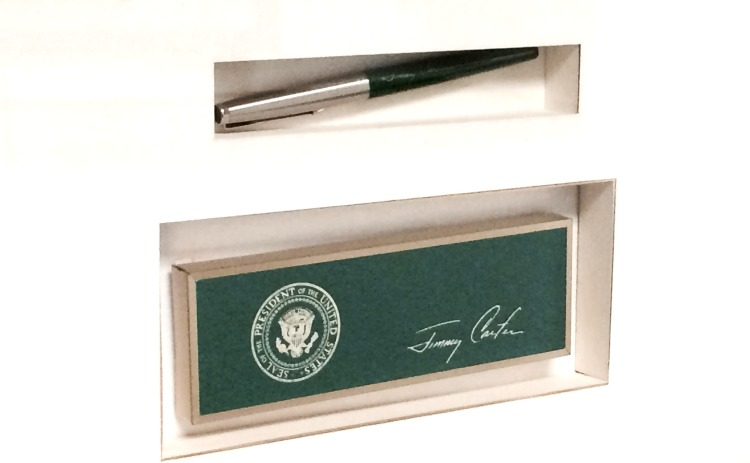 The pen and other mementos from then-President Jimmy Carter's signing of the USO charter are on display at the USO's Arlington, Virginia, offices. USO photo