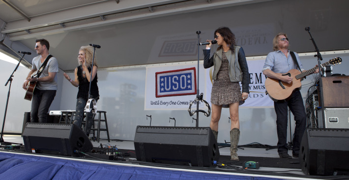 Members of Little Big Town perform for fans at the second annual Academy of Country Music/USO concert event at Nellis Air Force Base April 2, 2011. USO Photo by Fred Greaves