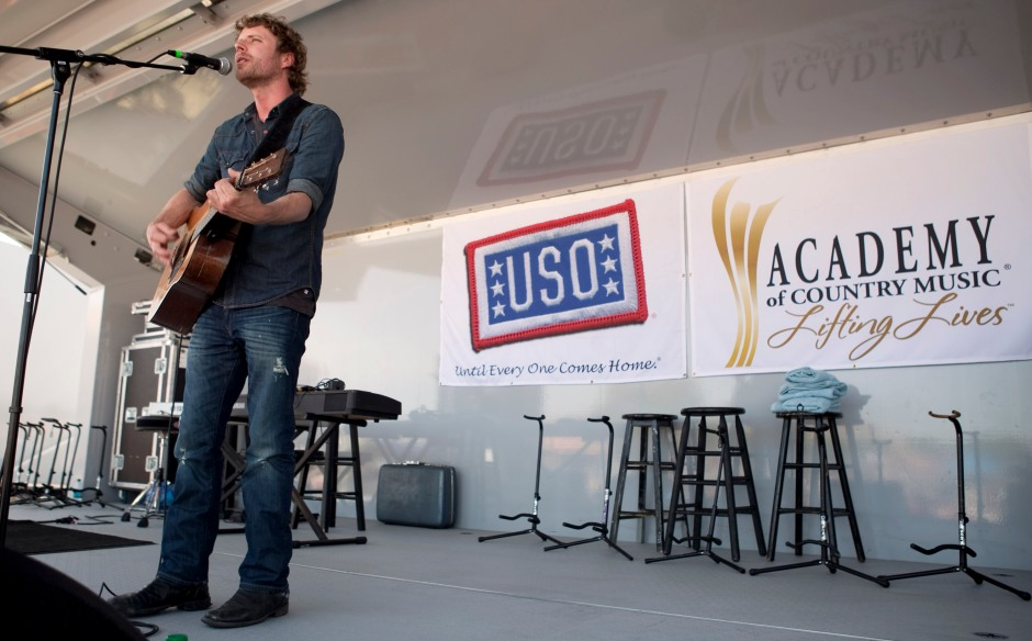 Country music artist Dierks Bentley performs during the USO/ACM Lifting Lives concert at Nellis Air Force Base in Las Vegas, NV, April 17, 2010. USO Photo by Fred Greaves