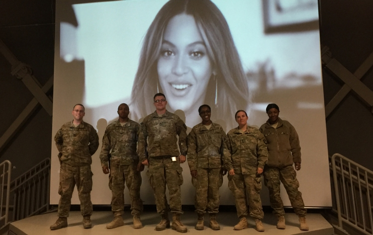 Troops smile after watching On the Run. USO photo