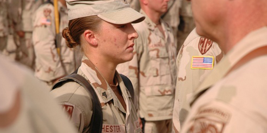 Sgt. Leigh Ann Hester stands at attention before receiving the Silver Star on June 16, 2005, at Camp Liberty, Iraq. DOD photo