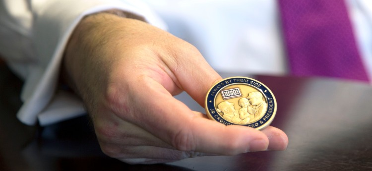 USO CEO and President Dr. J.D. Crouch II holds his recently minted personal coin.