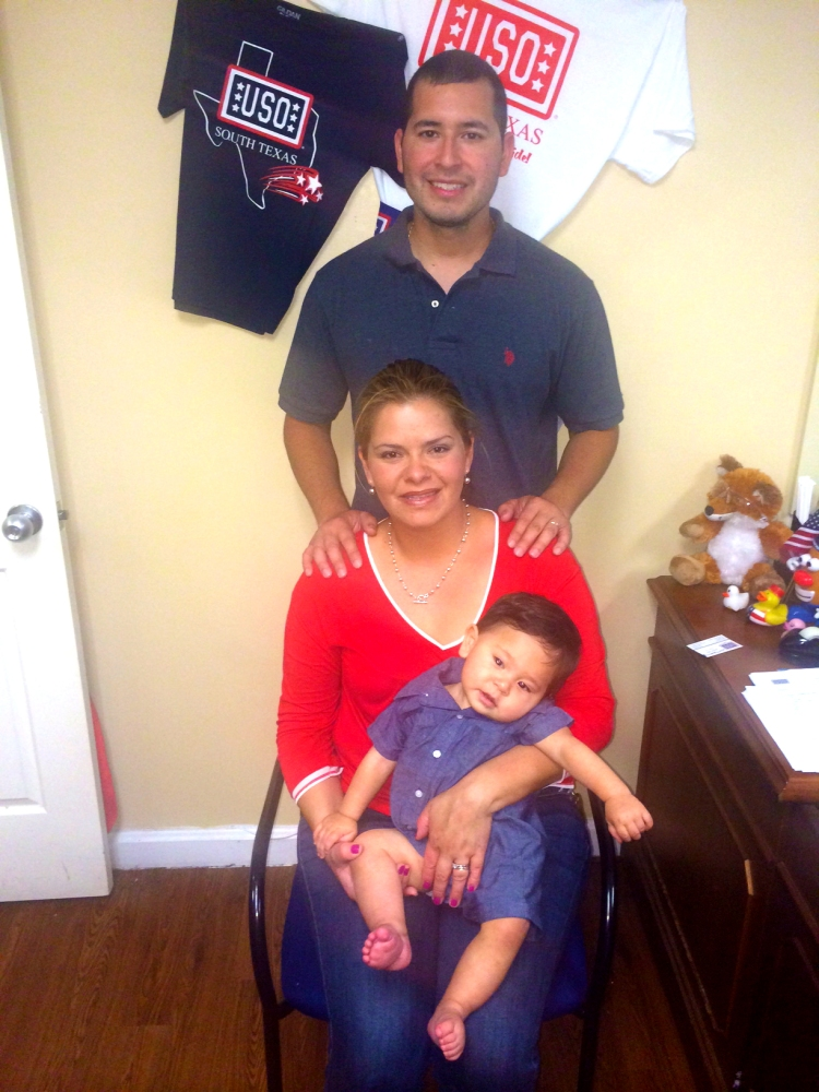 Petty Officer 2nd Class Cesar Tamayo, his wife Briciela and their son, Cesar. USO photo