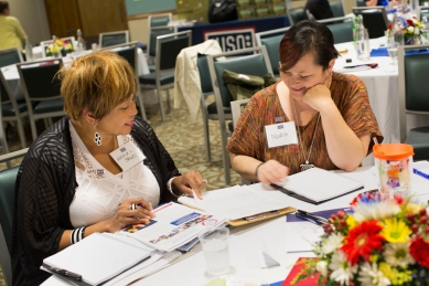 Angela Brooks, left, chats with another USO Caregivers Seminar attendee at Fort Leonard Wood, Missouri, last month. USO photo by Sandi Moynihan