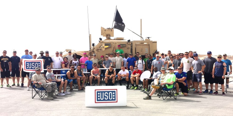 Troops in Qatar pose with  some gear from their USO2GO shipment. Courtesy photo
