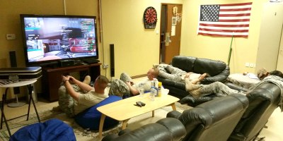Troops play video games - part of their USO2GO shipment - and use other USO2GO gear in Qatar. Courtesy photo