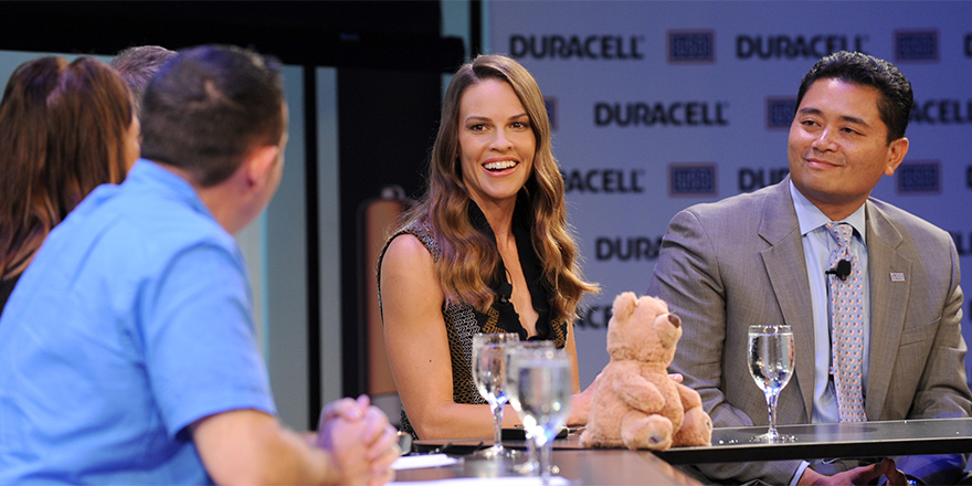 "Actress Hilary Swank, center, and USO Senior Vice President Alan Reyes participate in a panel discussion following the premiere of Duracell's new film ""The Teddy Bear"" on Thursday at The Times Center in New York. Courtesy photo"