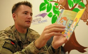 Navy Lt. Matthew Stroup records himself reading a book to his children during a United Through Reading event in Afghanistan. Photo courtesy of Matthew Stroup