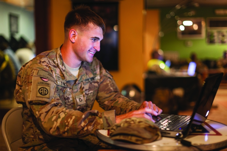 A service member uses the internet at the USO.