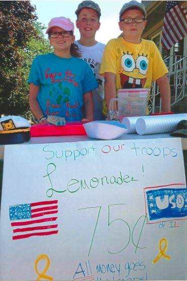 Marty, Jimmy and Nora McNaughton and their lemonade stand.
