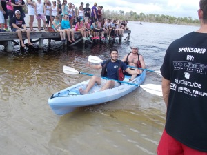 G.I. Theta Chi participants paddle a canoe at the University of Central Florida.