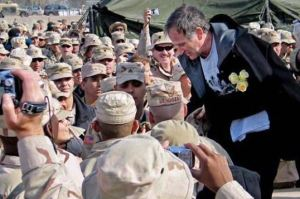 Robin Williams greets troops in Iraq during a 2004 USO tour. DOD photo