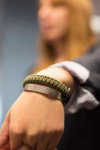 Sarah Kemp shows off one of her treasured 550 cord bracelets. USO photo by Joseph Andrew Lee