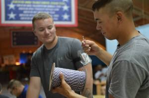 Troops select their cord colors. USO photo