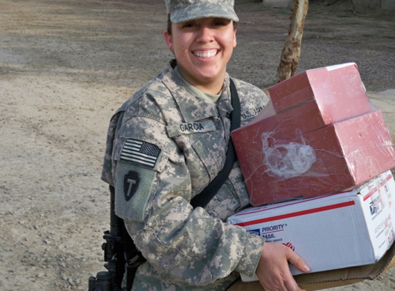 Pfc. Lucero Garcia, a native of Fort Worth, Texas, works hard and long hours as a frontline Soldier and still at the end of her shift is able to put on a smile. The mail Garcia has received today is spirit lifting and a welcomed sight from family members back home sending to their loved one. Garcia is deployed with Bravo Company, 949th Brigade Support Battalion, 10th Sustainment Brigade Troops Battalion, 10th Sustainment Brigade in support of Multi-National Division Ð Baghdad.