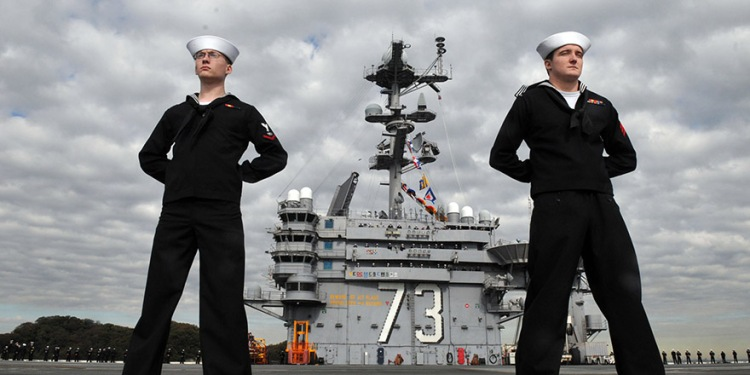 Sailors man the rails on the flight deck of the aircraft carrier USS George Washington. Navy photo
